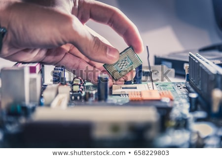 Computer processor in human hand Stock photo © simazoran