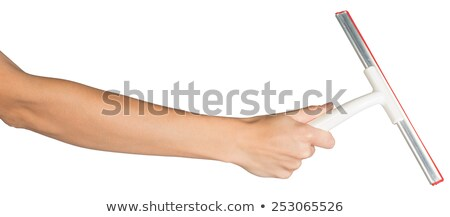 female hand holding squeegee stock photo © cherezoff
