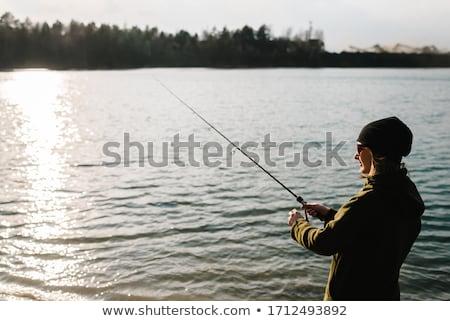 Donna pesca pier stagno primavera donne Foto d'archivio © phbcz