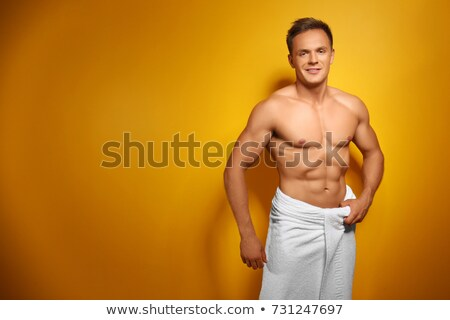 Muscolare uomo giallo asciugamano ritratto a torso nudo Foto d'archivio © wavebreak_media
