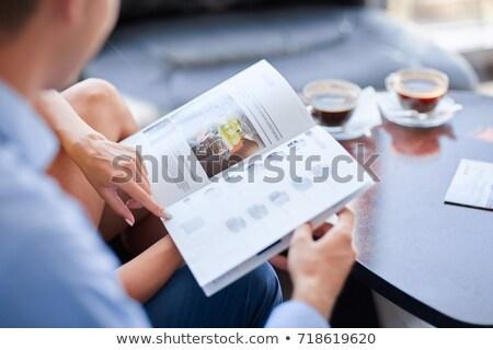 Uśmiechnięty para czytania broszura showroom Zdjęcia stock © wavebreak_media
