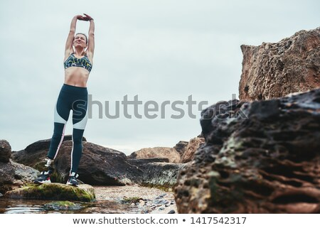 Disabled woman with arms outstretched at the beach Stock photo © wavebreak_media