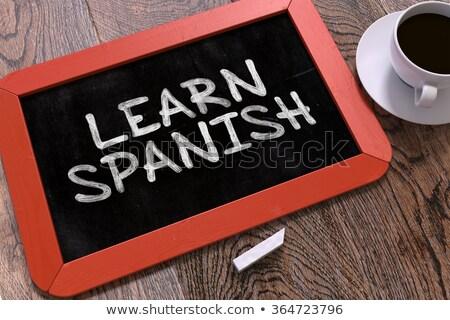 öğrenmek İspanyolca kara tahta bulanık yazı Stok fotoğraf © tashatuvango