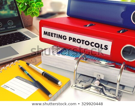 Stock photo: Meeting Protocols on Red Office Folder. Toned Image.