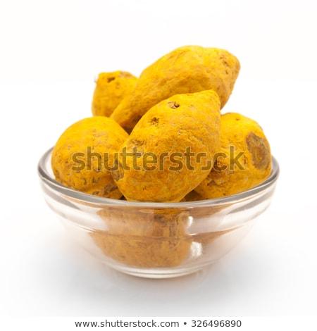 front view of bowl of organic round turmeric stock photo © ziprashantzi