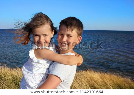 two little girls sit ashore in water Stock photo © Paha_L