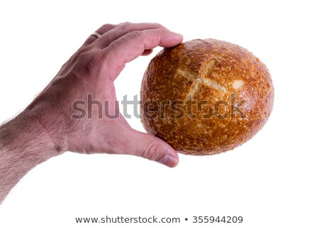 Clean male hand gently holding a sourdough bread Stock photo © ozgur