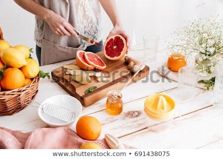 新鮮な グレープフルーツ カット 若い女性 キッチン ストックフォト © deandrobot