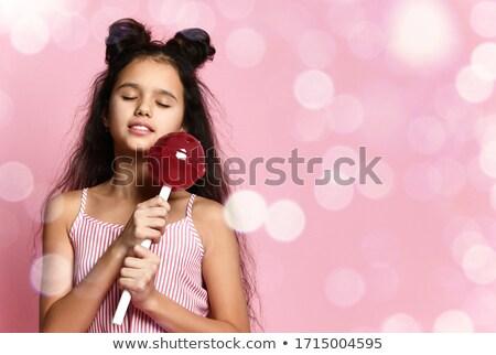 Dziewczyna czerwona sukienka ogromny lizak piękna młoda kobieta Zdjęcia stock © svetography