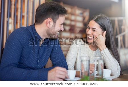Pareja coquetear restaurante retrato jóvenes sonriendo Foto stock © deandrobot