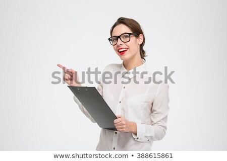 portrait · femme · d'affaires · dossiers · femme · travaux · costume - photo stock © deandrobot