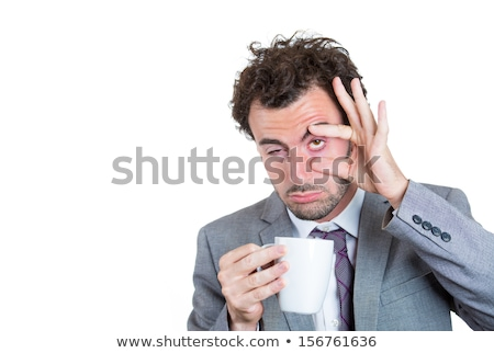 Waking man struggling to drink coffee Stock photo © ozgur
