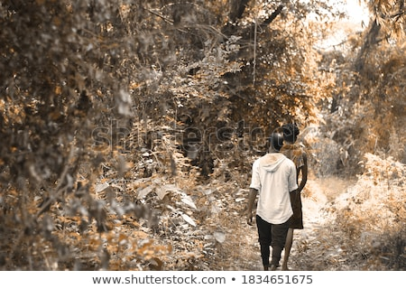 Smiling attractive bearded man with axe in winter forest Stock photo © deandrobot