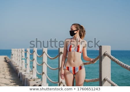 Woman on beach in Dubai UAE with swimwear Stock photo © Kzenon