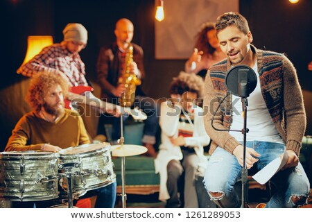 practicing his electric guitar in a jam room stock photo © sumners