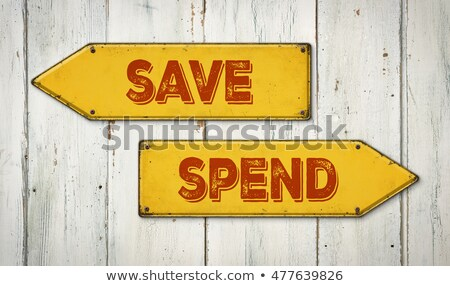 Direction signs on a wooden wall - Save or Spend Stock photo © Zerbor