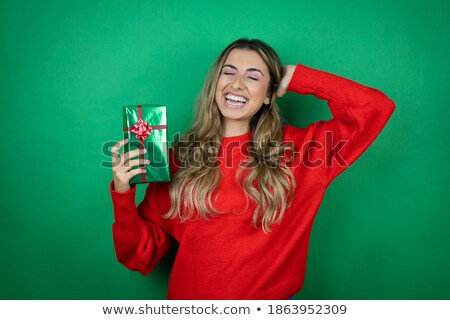 beautiful blonde woman holding hand behind neck and smiles stock photo © feedough
