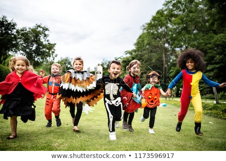 Kids wearing costumes for halloween and plays Stock photo © bluering