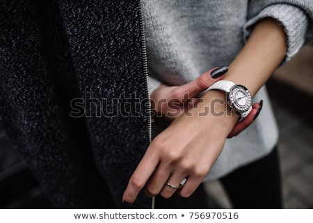 Beautiful girl with wrist watches Stock photo © svetography