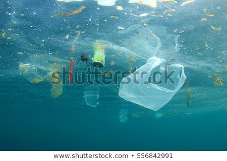 Plastic rubbish pollution in ocean Stock photo © michaklootwijk