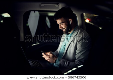Handsome young man sitting in the limousine Stock photo © konradbak