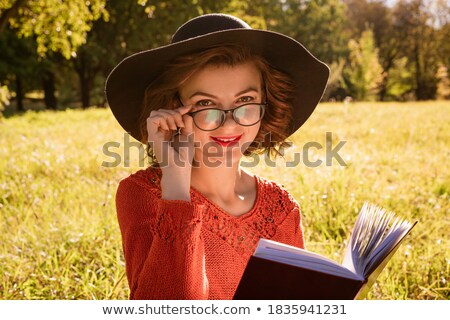 Real woman in glasses in autumn park Stock photo © dariazu