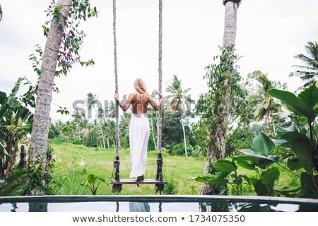 beautiful blond woman on swing against white Stock photo © julenochek