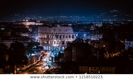 famous view of rome by night stock photo © vwalakte