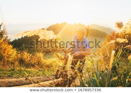 Mountain biker pushing his bike Stock photo © IS2
