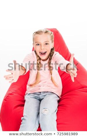 Animado criança brasão sessão vermelho saco de feijão Foto stock © LightFieldStudios