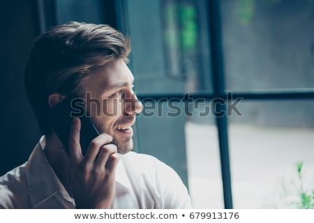 side view of a young man talking on the phone stock photo © feedough
