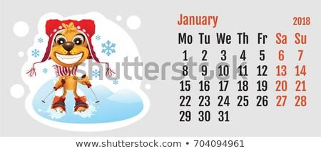 2018 year of yellow dog on chinese calendar fun dog skier calendar grid month january stock photo © orensila