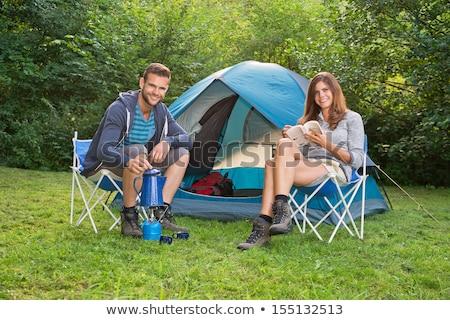 férfi · kamera · kempingezés · sátor · hátizsák · fókusz - stock fotó © O_Lypa