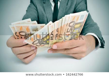 üzletember Euro számlák üzlet pénz férfi Stock fotó © IS2