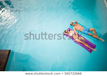 Homem mulher flutuante piscina beleza Foto stock © IS2