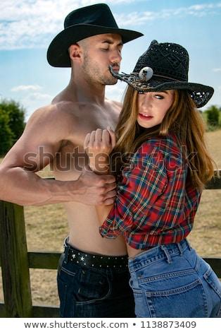 привлекательный · молодым · человеком · черный · ковбойской · шляпе · сено - Сток-фото © keeweeboy