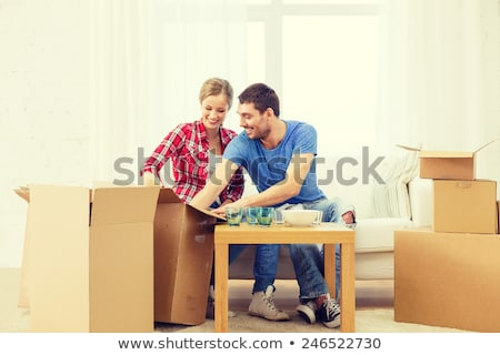Couple unpacking kitchenware from boxes Stock photo © IS2