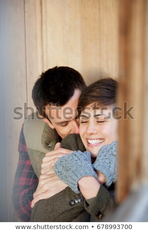 Couple cuddling in a hut in a park Stock photo © IS2