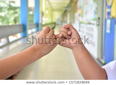 Two hands hook each other's little finger Stock photo © deandrobot