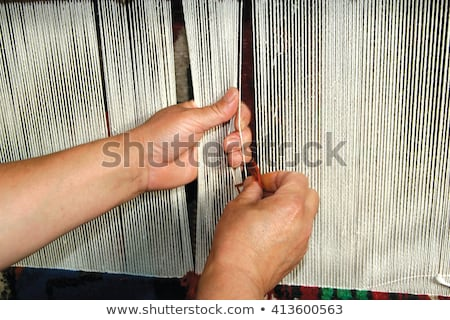 Stock photo: making carpets from a rope