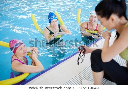 Alegre entrenador altos piscina Foto stock © wavebreak_media