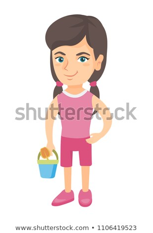 Caucasian girl in shorts holding pail and shovel. Stock photo © RAStudio