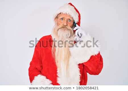 portrait of angry santa claus speaking on the phone Stock photo © feedough