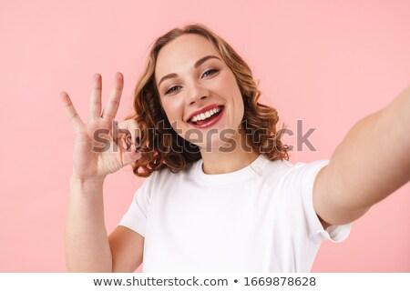 Zdumiewający młodych szczęśliwy kobieta odizolowany różowy Zdjęcia stock © deandrobot
