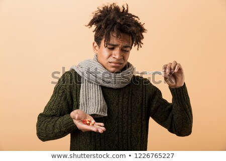 Portrait of a sad african man dressed in autumn clothes Stock photo © deandrobot