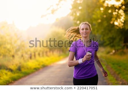 Woman in spring running or jogging as sport Stock photo © Kzenon