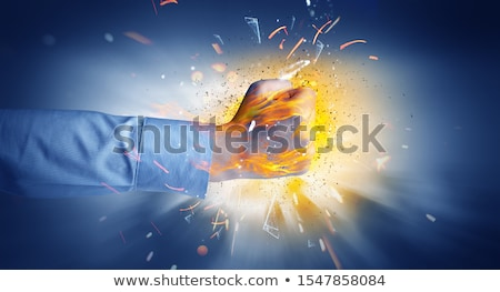 Hand hits intense and makes fire Stock photo © ra2studio