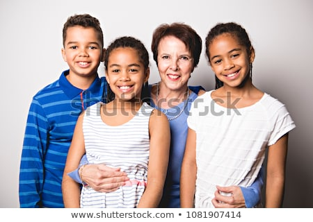 black twin girls and boy child with grandmother in studio white background Stock photo © Lopolo