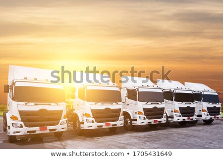 truck traveling fast to a commercial port at sunset stock photo © alphaspirit