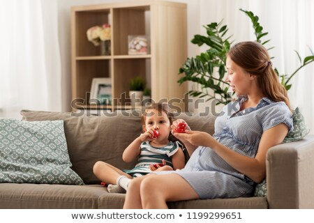pregnant mother and daughter playing tea party Stock photo © dolgachov